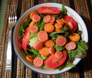 Bowl of Salad Topped with Pink Pickles