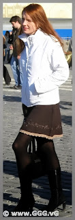 Girl in skirt and white jacket