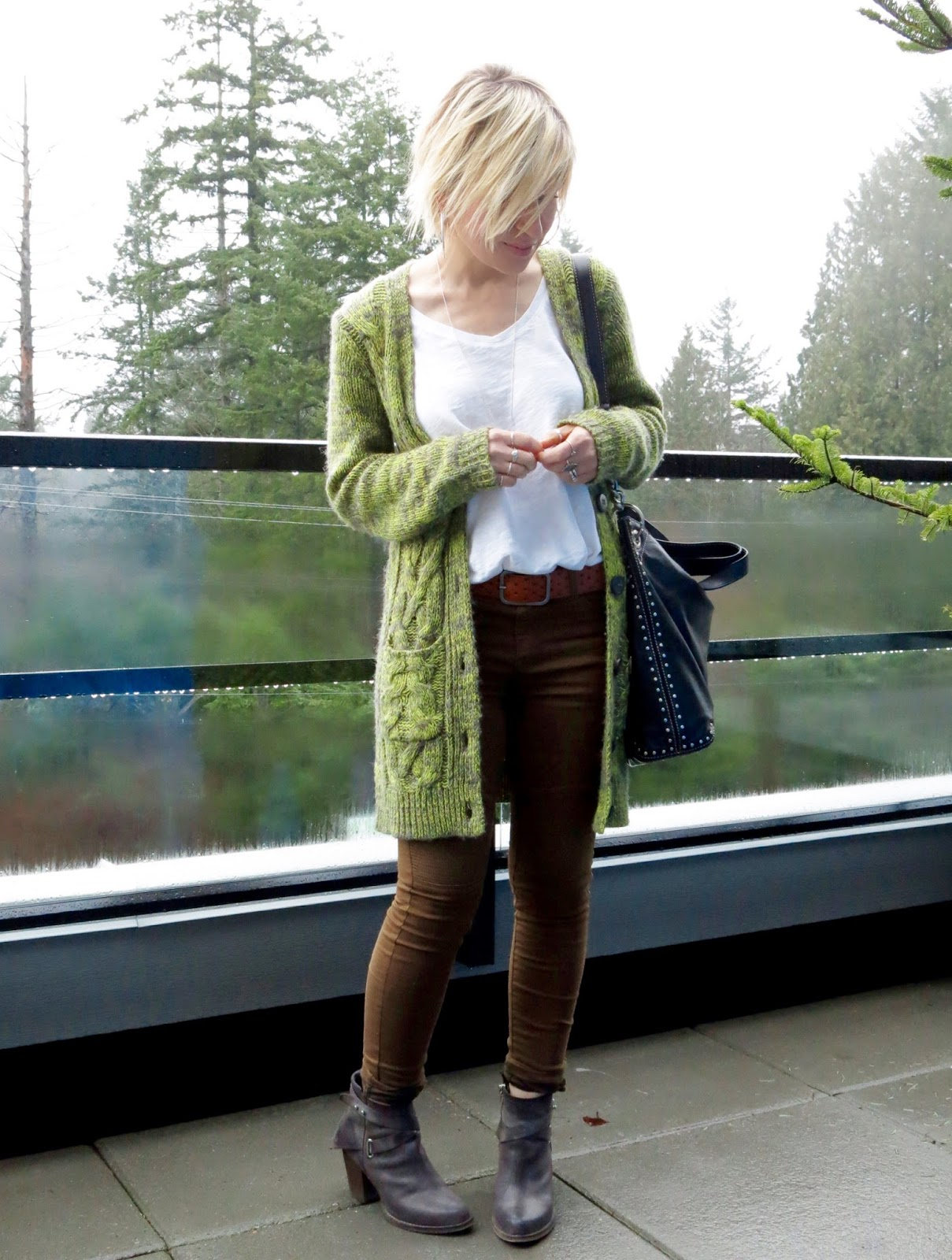 styling a slouchy white tee and khaki skinnies with a grandpa cardigan and ankle booties