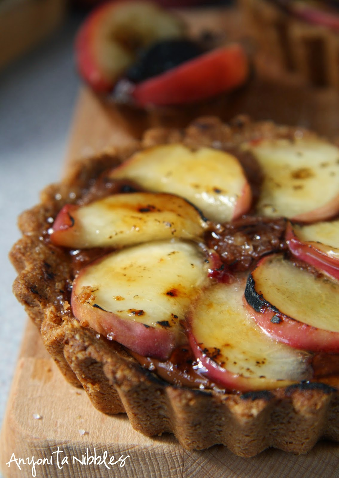 Lightly burnished peaches in a peach & Nutella tart by Anyonita Nibbles