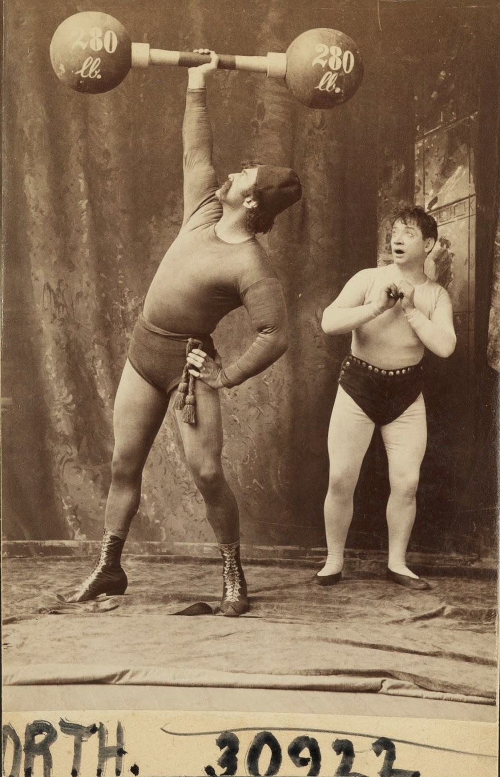 Portrait of strong man performer Herbert Bosworth and an admirer, ca ...