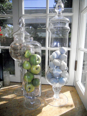 Spring decor in apothecary jars turn plastic easter eggs into faux robin eggs - diy