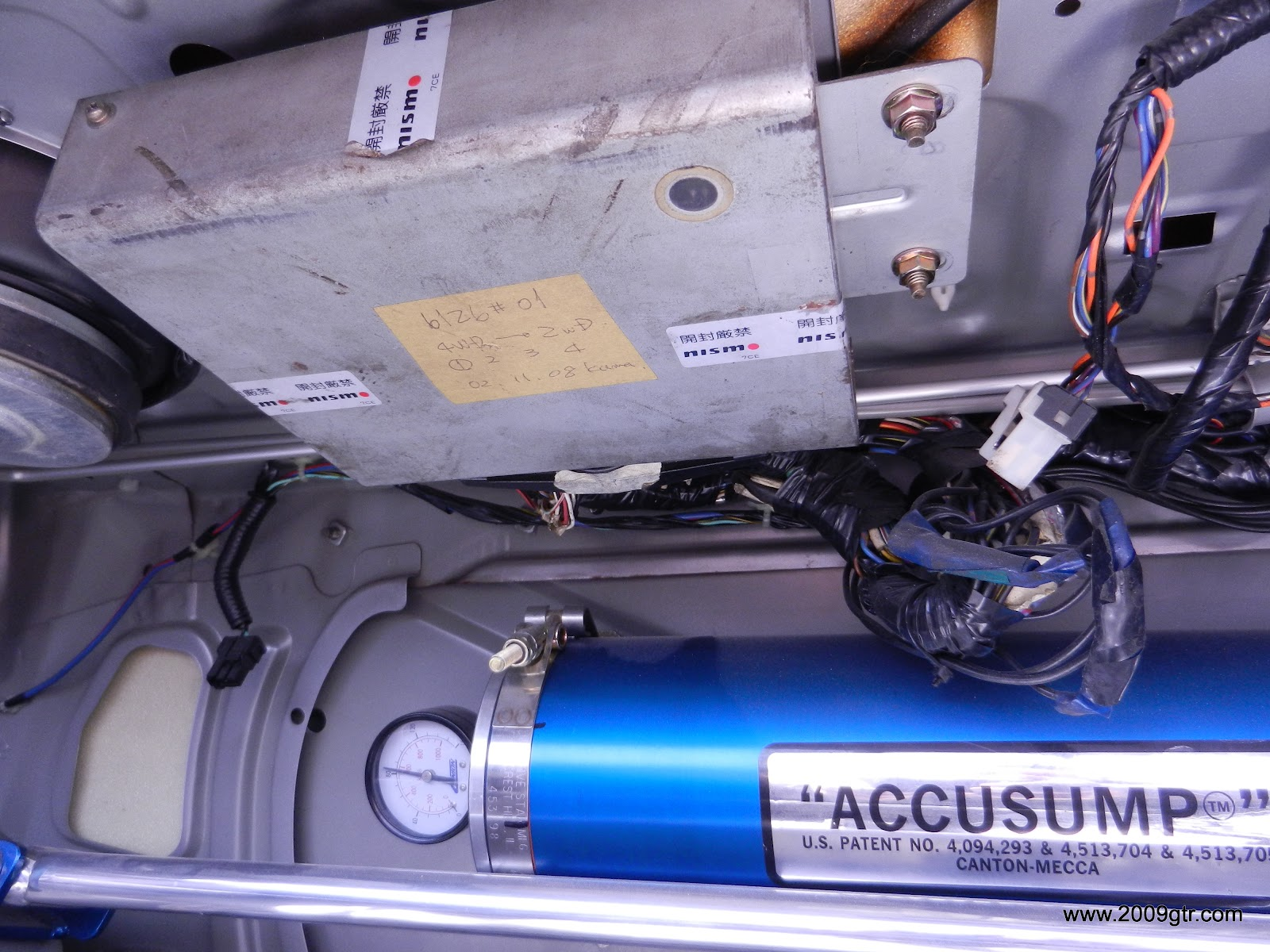 ATTESA ECU in the trunk of an R32. LED window visible on right rear corner