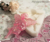 http://en.dawanda.com/product/49451198-victorian-angel-with-heart-silicon-mould-141