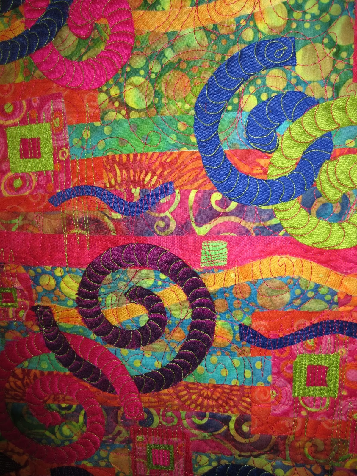art quilt of batiks and the swirls made out of silk; free motion ...