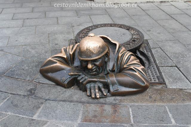 "socha ""Čumila"" // a golden statue"