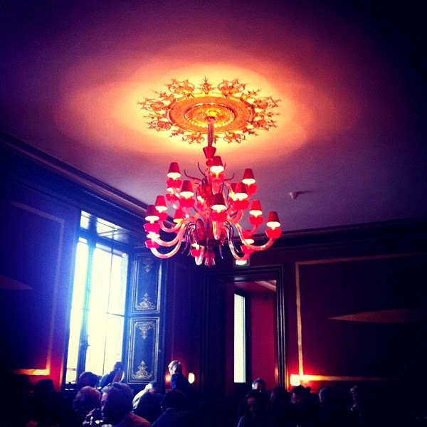 Le Cafe Marly red glass chandelier at the Louvre in Paris