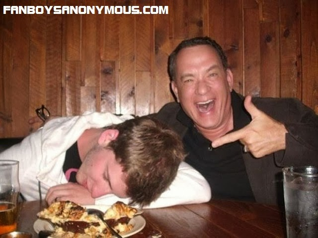 Forrest Gump actor and comedian Tom Hanks takes photos with sleeping drunk student