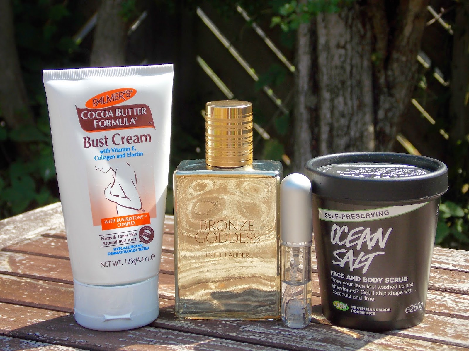 Palmer's Cocoa Butter Formula Bust, Estee Lauder Bronze Goddess Eau Fraiche Skinscent, Travolo and Lush Ocean Salt Face and Body Scrub