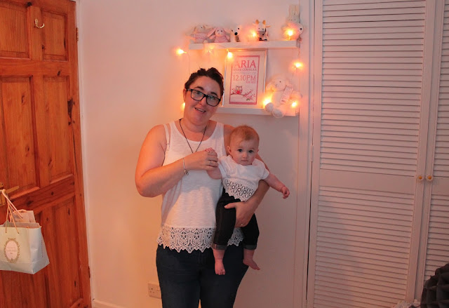 mother & daughter wearing matching clothes. Jeggings with a white crochet hem t-shirt