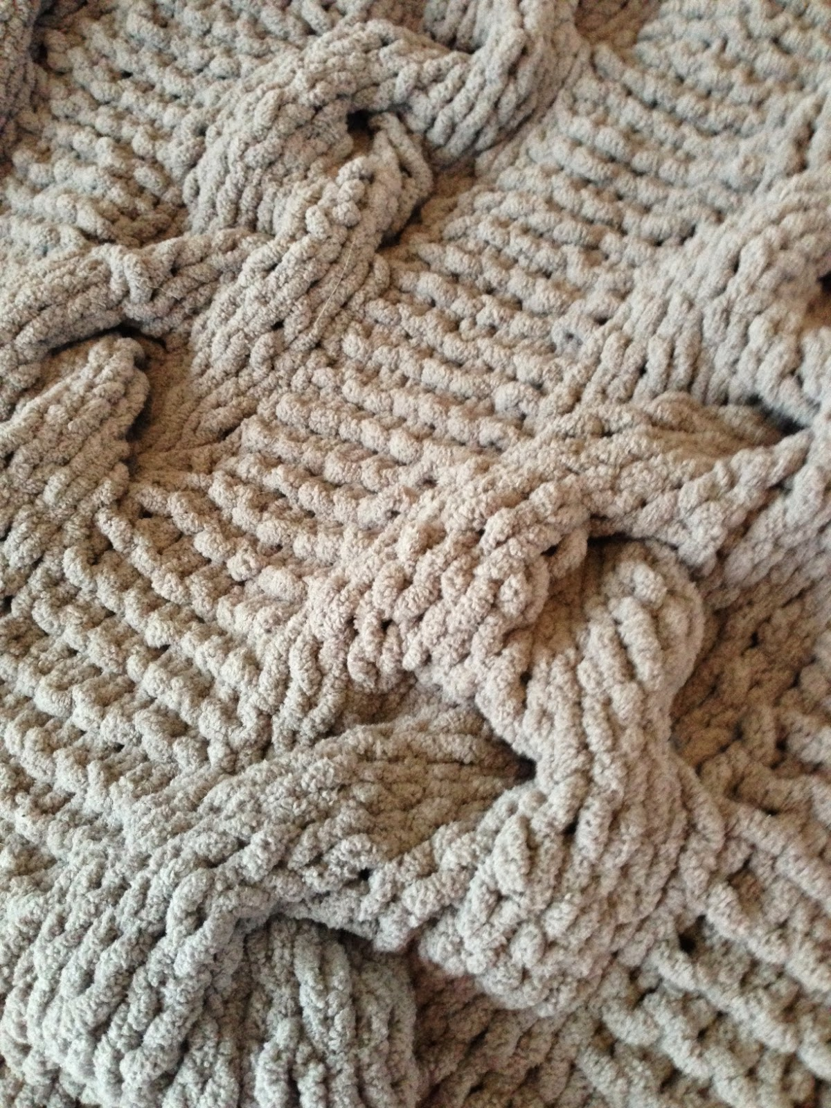 Knitted cable blanket closeup