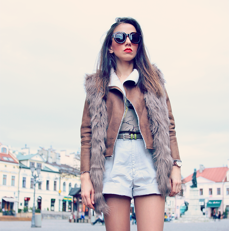 faux fur vest over leather jacket