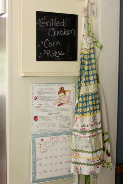 Susan Branch calendar and chalkboard menu in kitchen via www.goldenboysandme.com