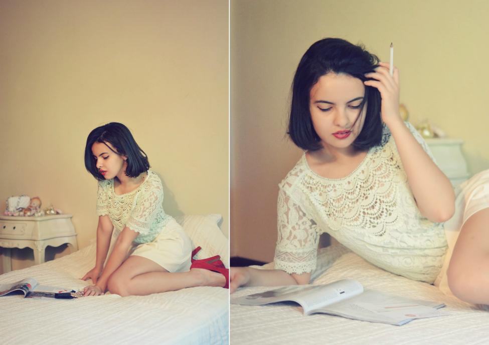 theserialshopper posing in a boudoir decor, reading magazine
