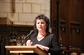 A picture of Carol Ann Duffy carrying out a poetry reading at Southwark Cathedral