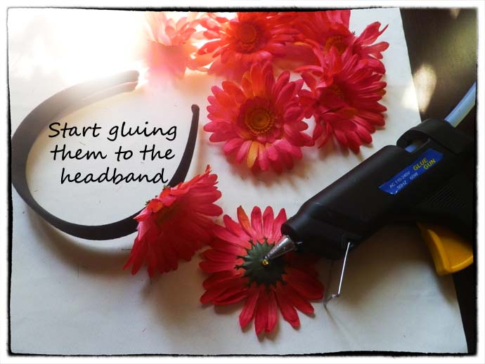 DIY project step 3: start gluing the flower heads to the headband using the glue gun
