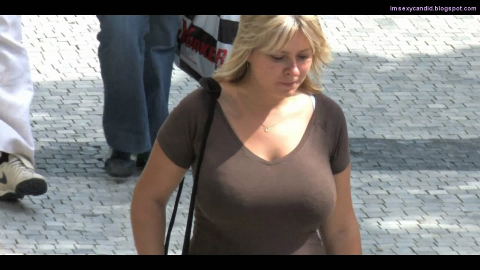 Milf Big Boobs Bouncing On Street Mp Snapshot B