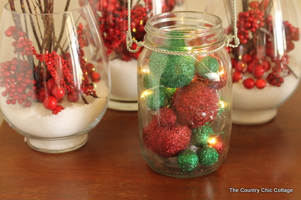 Glitter Mason Jar Christmas Luminary -- click the picture to get the full instructions on how to add this fun mason jar luminary to your Christmas decor.
