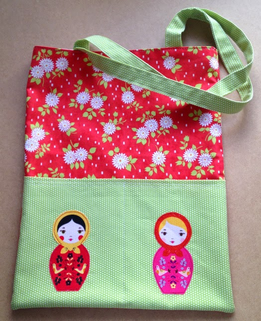 Tote with applique pockets