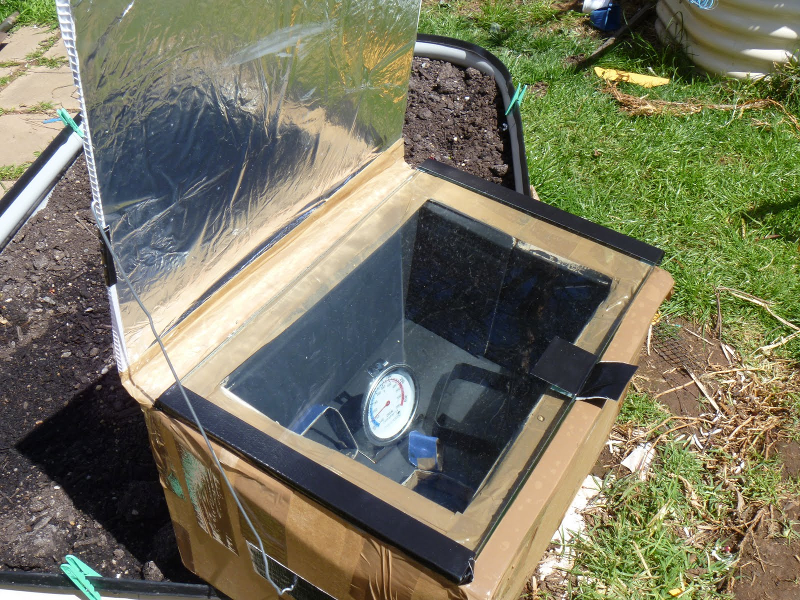 Toward sustainability with three kids the kids made for How to build a solar oven for kids