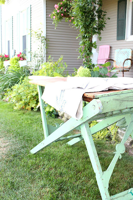 Upon one final peek around, I spotted this antique, wooden ironing board. I  have never seen any like it before and I knew I had to take it home with me! - Flea Market Finds...a Vintage Upholstery Factory Cart And Wooden