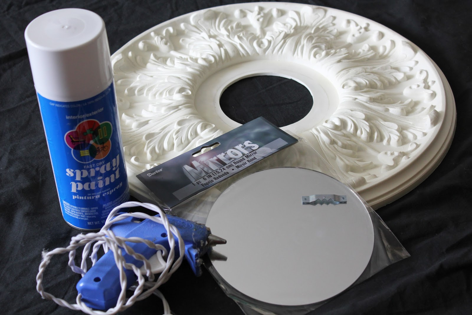 spray paint glue gun 6 round mirror that can be bought at michaels. Black Bedroom Furniture Sets. Home Design Ideas