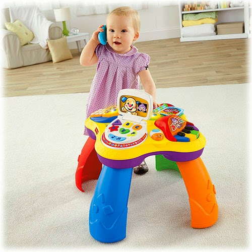 Libros y juguetes 1demagiaxfa toys bebe fisher for Mesa fisher price