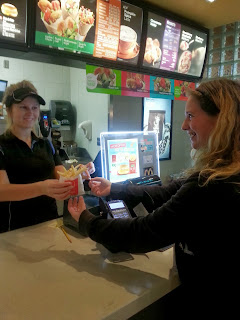 McDonalds Lindsay Employee hands Free Fries to Happy Customer