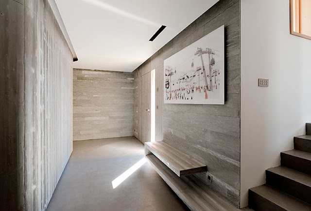 Soft Brown Wall Made from Wooden Material and White Painting Hanged in the Wall