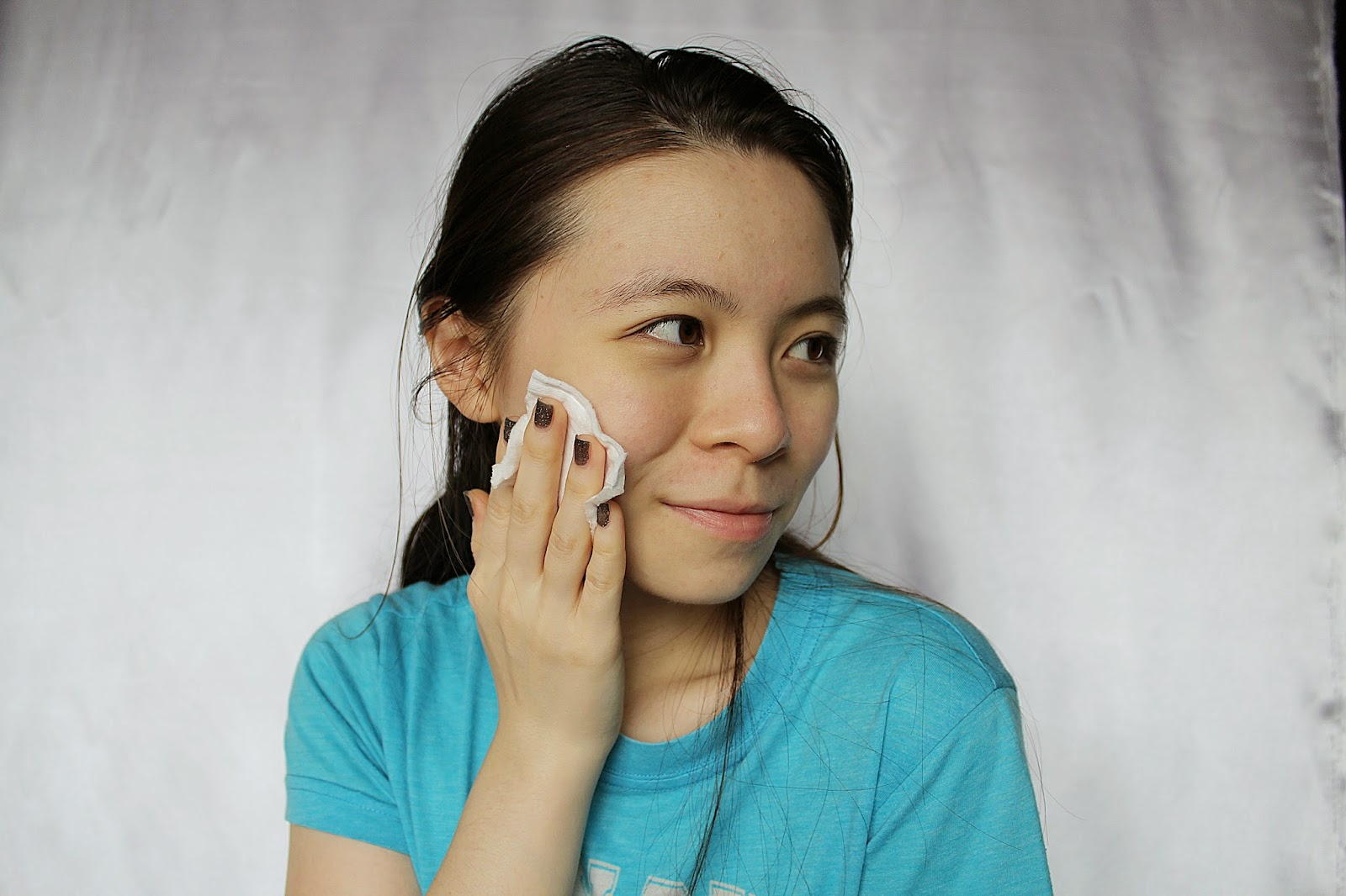 girl applying skincare on face