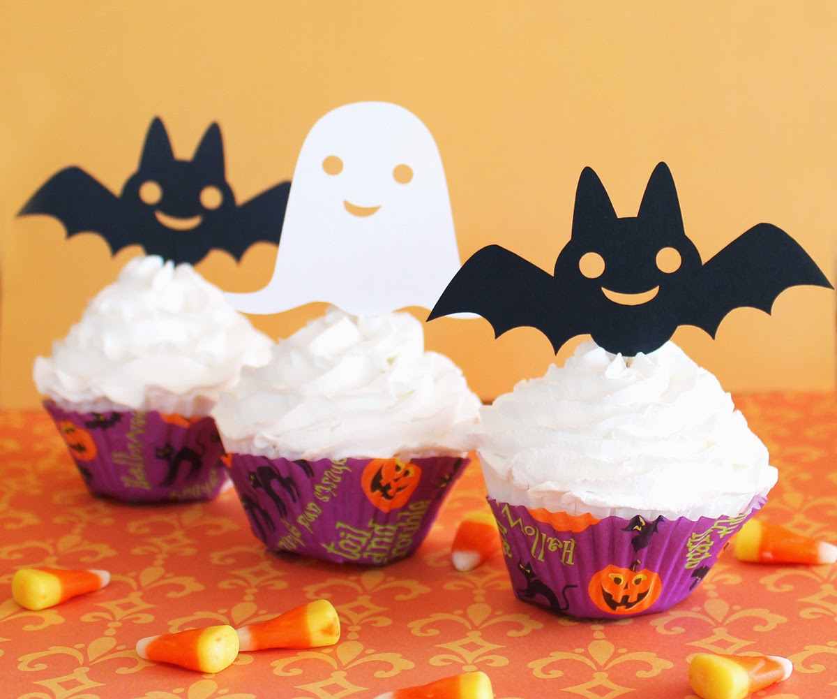 http://www.tiffzippy.com/halloween-cupcake-toppers/