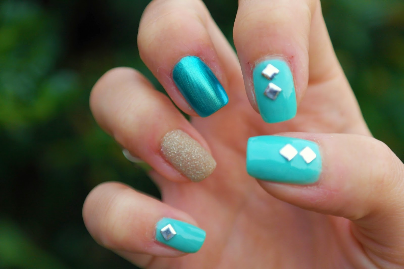 turquoise nail polish with studs