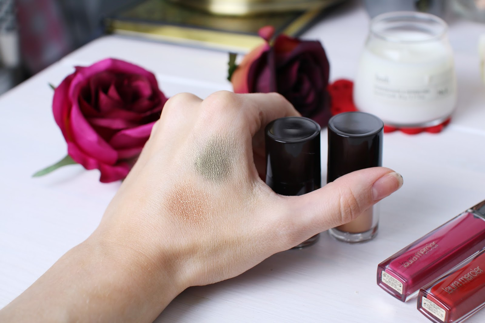 Laura Mercier Fairy Dust in copper and onyx