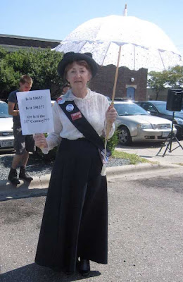 Woman dressed as a suffragist