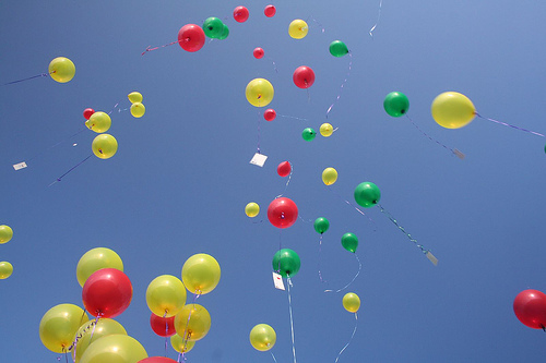 yellow, red, and green balloons