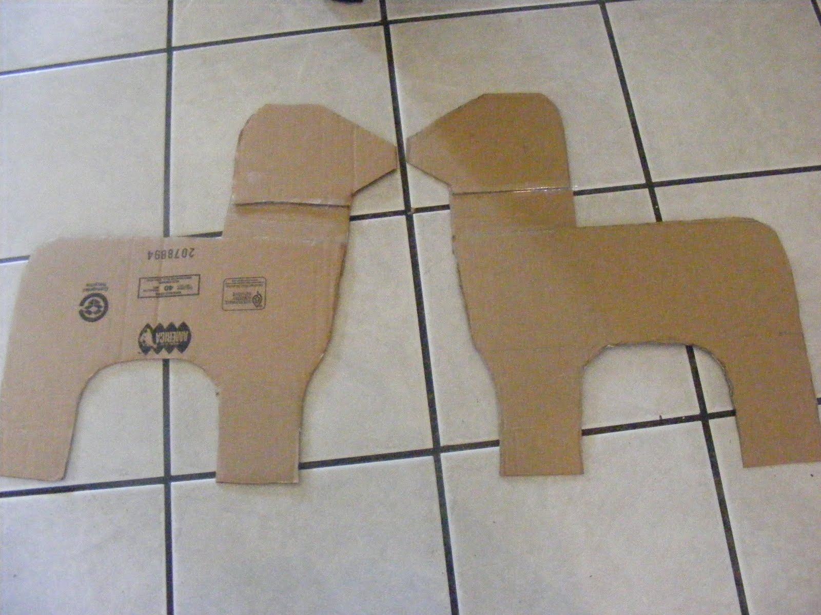 How To Make A Pinata With A Cardboard Box -  i know he still looks kinda doggy like bear with me the ears will make him look more like a donkey