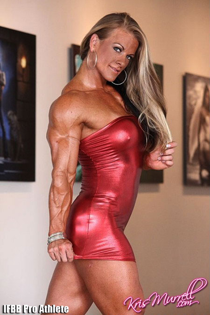 Kris Murrell Flexing Her Shredded Tricep And Built Muscles