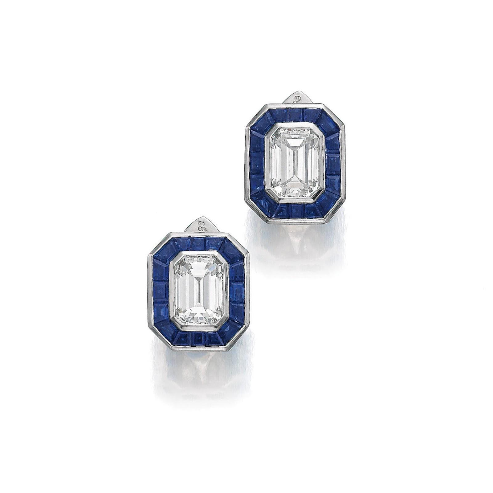 A Pair Of Calibrecut Sapphire And Emeraldcut Diamond Earrings