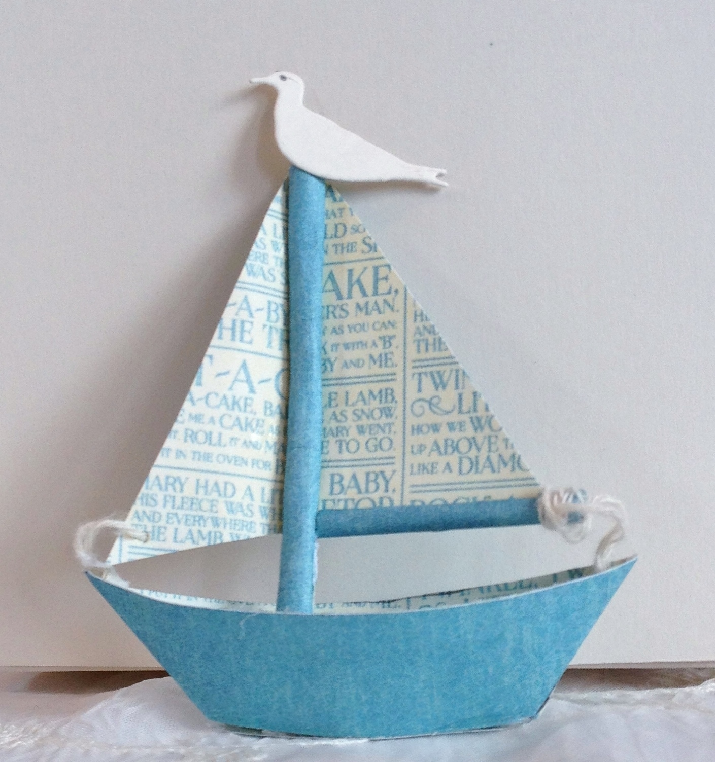 how to make the tiny paper sailboat for the precious memories photo