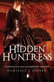 Cover of Hidden Huntress, featuring a red-haired white woman wearing an elaborate black gown with corseted bodice and a full, runched skirt. She carries a black lace fan and stands in a red-tinged theatre with elaborate moldings.