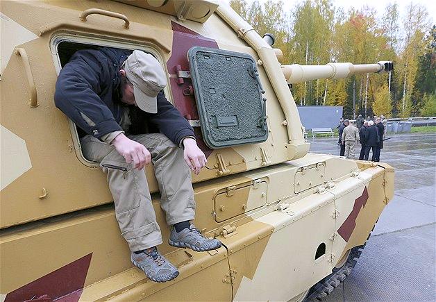 A Bosnian soldier demonstrates an anti-tank weapon