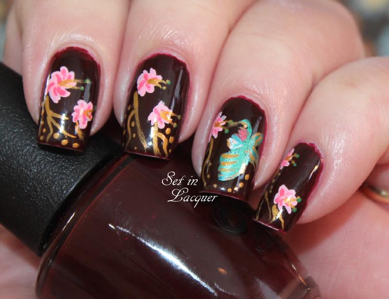 Floral and hummingbird nail art