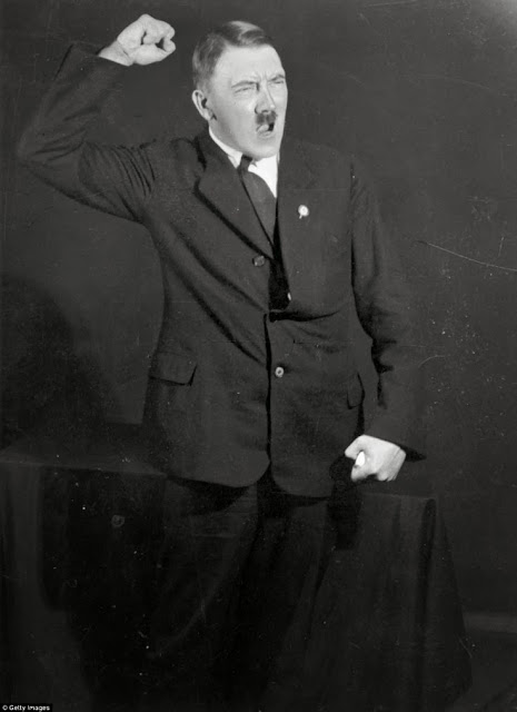 Newly released photographs taken in 1925 by photographer Heinrich Hoffman show Adolph Hilter rehearsing his speeches