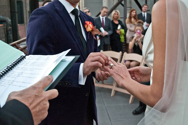 A Model Wedding, ring exchange on a rooftop wedding