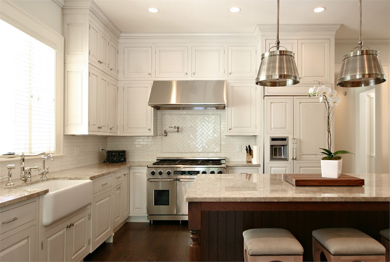 White tile herringbone backsplash set over the stove. Dresser Homes  title=
