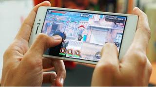 Ilustrasi gambar bermain game pada gadget (Oik Yusuf - Kompas Tekno)