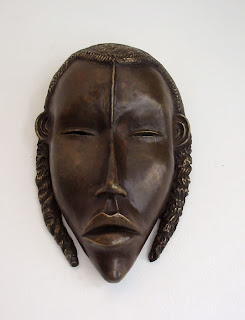Art africain, masque en forme de visage