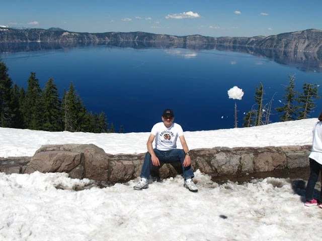 Crater Lake in Oregon, USA - A Wonderful PHOTO JOURNEY WITH Saurabh RathoreSaurabh visited Carter Lake few weeks back with his friends and they did camping around the lake. Let's have a PHOTO JOURNEY to Crater Lake with Saurabh...Crater Lake is a caldera lake located in the south-central region of the U.S. state of Oregon. It is the main feature of Crater Lake National Park and famous for its deep blue color and water clarity. The lake partly fills a nearly 2,148-foot (655 m) deep caldera that was formed around 7,700 (± 150) years ago by the collapse of the volcano Mount Mazama. There are no rivers flowing into or out of the lake; the evaporation is compensated for by rain and snowfall at a rate such that the total amount of water is replaced every 250 years. [Source: Wikipedia]Conquering the lake. The mountains look almost blue and the entire scenery has only two colours: Various shades of blue and white.Getting ready to camp in the wilderness. There's no feeling more liberating. Despite the snow, there was no need to cover oneself under layers of clothes.Camps all ready. T-shirts amongst the snow. Sounds like a bollywood concept. I think this is the Wizard island. It puts its head out through the waters. The color of the vegetation is darker. The site is considered sacred by the klamath tribe of Native Americans. Their ancestors are supposed to have witnessed the collapse of the maountain. The trek seems easy in pictures but wasn't without its own difficulties.Pine trees jutting out of the untouched blanket of snow. A sight very common in these surroundings. This looks like the original surface of Mount Mazama whose collapse had formed the crater. I can't be sure though. Look at the layers of snow behind. It seems that the snow in these parts of the world hasn't melted in centuries.The road appears more snake like in this area than any other because it's blackness is emphasized by the white surroundings.The round shape of the crater is very clear here. It is amazing how nature seems to favour round and spherical things. Our vehicle - comfortable and elegant - perfect for such terrain.This looks like fresh snow. I still  cannot understand the comparatively warm temperatures.The rocky terrain is mostly hidden under the thick layers of snow. The terrain can be trecherous so caution is advised.Here begins our time as explorers.