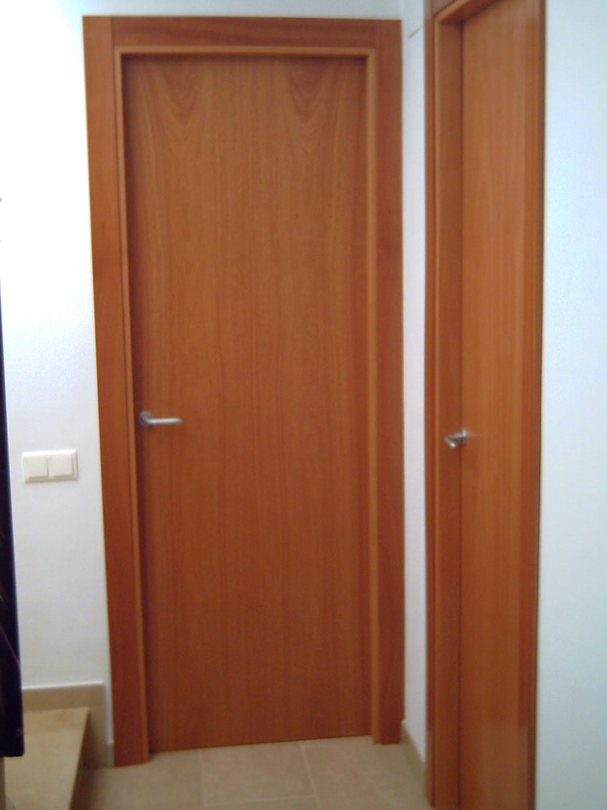 Ca uelo e hijos carpinteria s c p puertas for Puertas madera minimalistas