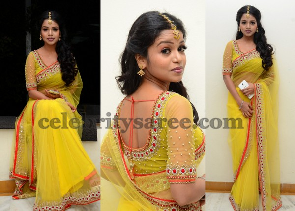 4a2d3b001b8434 South actress Bhavya wearing Bright yellow netted designer saree with stone  work border